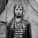 Gina, a Kalderash Roma girl from Baltaeni camp. The wearing of a headscarf shows that she is married. April 1993